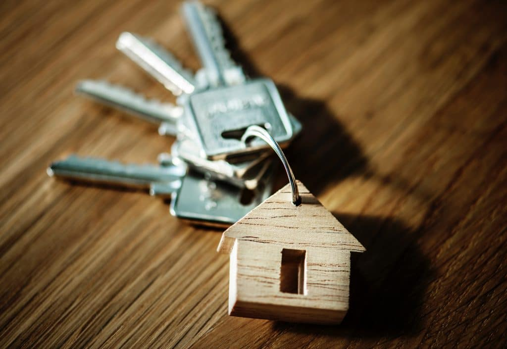 house keys with home wooden keychain